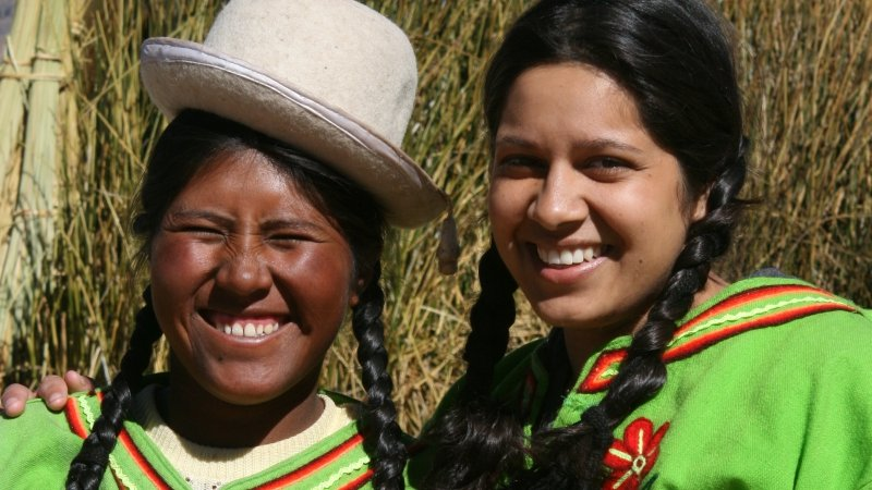 Friendly Uros Indian ladies on Lake Titicacas Reed, Peru.jpg