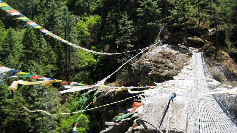 Flags over a suspension bridge, Nepal