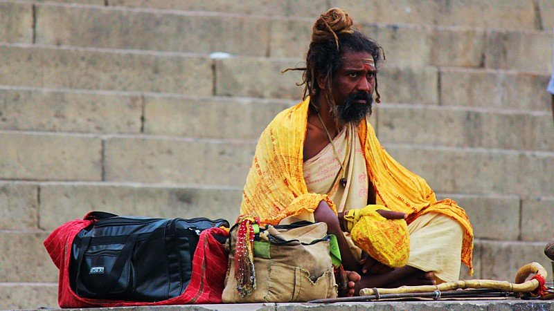 Indian holy man by the Ganges river, Varanasi, India