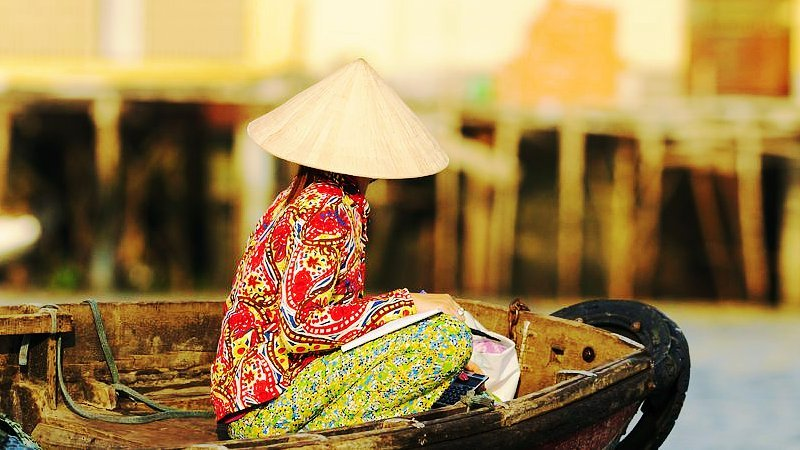 Lady on a boat, Mekong delta, Thailand