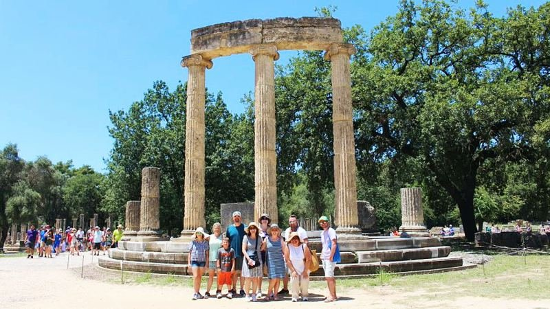 Group of tourists at archaeological site of Olympia, Greece